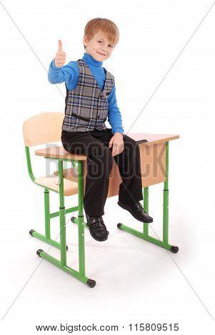 Boy Success. Boy Sitting On The School Desk