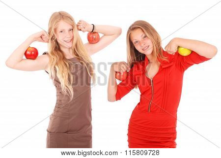 Two Girls Holding Apples On Her Biceps