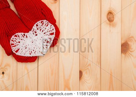 Valentines Day Background. Girl Holds White Knitted Heart In Red Mittens