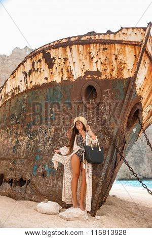 Beautiful Young Girl In A Beach With Shipwreck