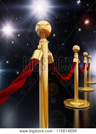 Gold stanchion posts and red velvet ropes under the night