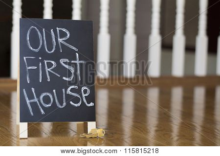 our first house sign with keys