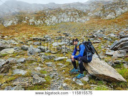Hiker With Backpack Having A Break