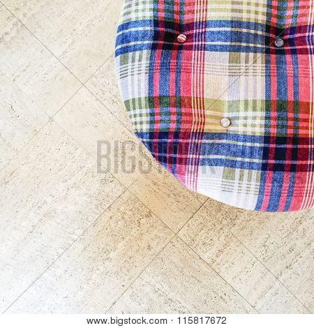 Checked Velvet Stool On Tiled Floor