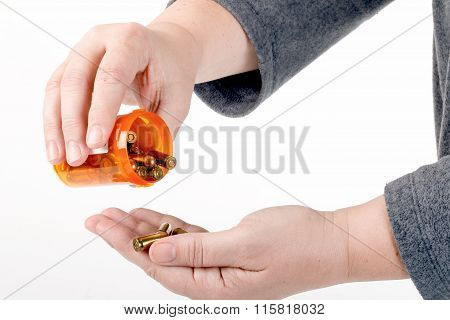 Pouring Bullets From A Pill Bottle