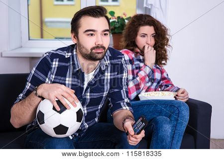 Man Watching Football With His Bored Girlfriend