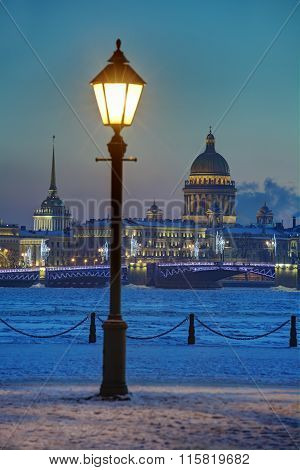 Street Light On Embankment Neva River, Winter Evening, Saint-petersburg, Russia.