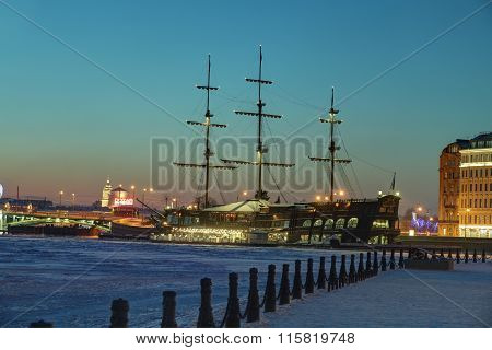 Ice-bound Sailboat Floating Restaurant, Winter Evening In Saint Petersburg, Russia.