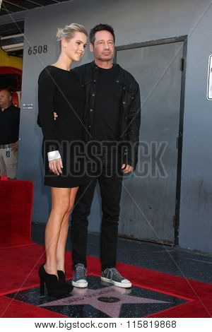 LOS ANGELES - JAN 25:  Claire Holt, David Duchovny at the David Duchovny Hollywood Walk of Fame Star Ceremony at the Fox Theater on January 25, 2016 in Los Angeles, CA