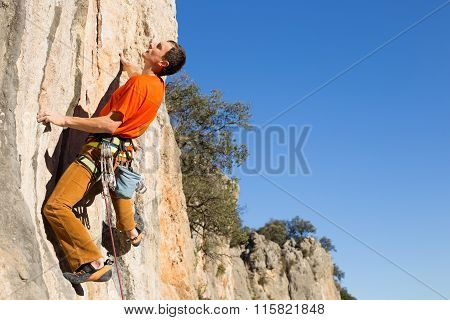 Sportsman climbing on the rock.