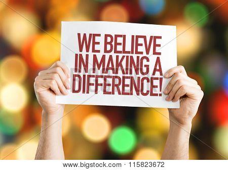 We Believe in Making a Difference placard with bokeh background