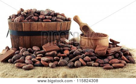 Aromatic cocoa beans and chocolate isolated on white background, close up
