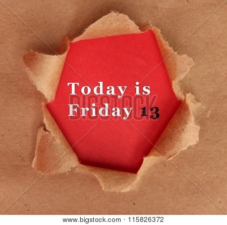 Torn craft paper with red background and text Today is Friday 13