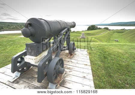 Historic defence, cannons, now relics of the past, sit on their mounts.