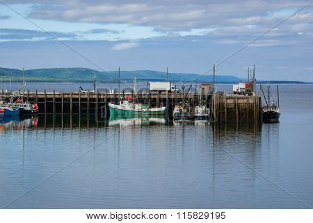 Fishing boats in the harbour at low tide in Digby, Nova Scotia.