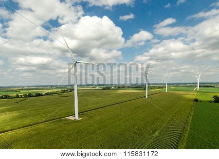 Large windmills in field