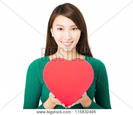 Beautiful Young Woman Holding Red Heart Gift Box