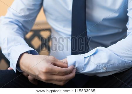 Young Man In Business Office Shirt Buttoning His Sleeve Buttons