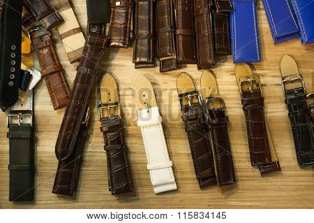 Many Vintage Watch Straps On Wood Table For Repair