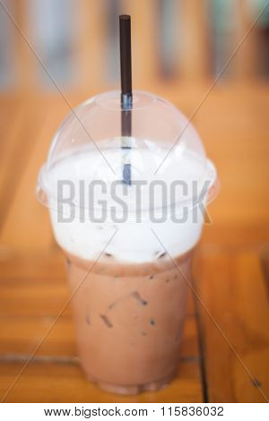 Iced Mocha Coffee In Glass On The Table