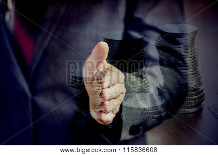 Double Exposure Businessman In Suit Ready To Handshake With Coin Stacking. It Indicates Many Aspects