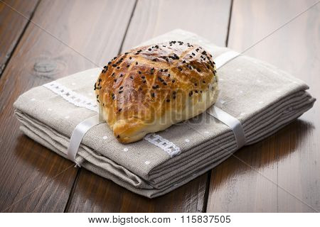 Traditional Turkish pastry with black cumin seeds called pogaca