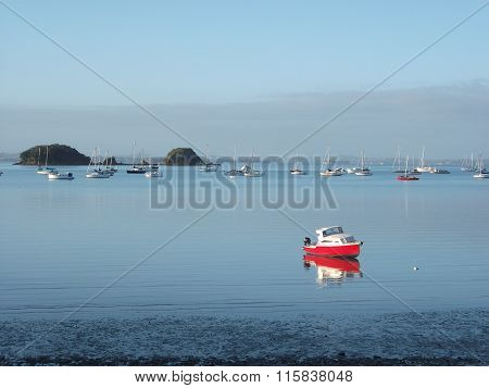 Calm waters with boats anchored