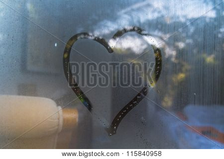 abstract heart shape on hazy glass in the morning