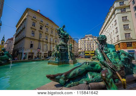 Vienna, Austria - 11 August, 2015: Very nice fountain with statues and beautiful green water located
