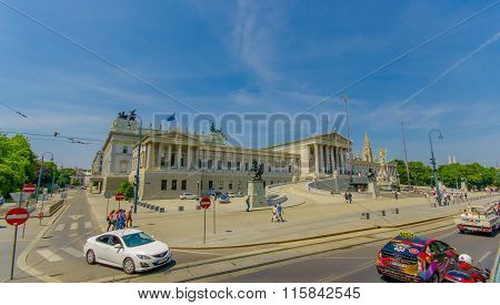 Vienna, Austria - 11 August, 2015: Beautiful facade and frontal view of parliament building with spe