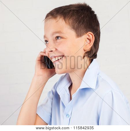 Boy talking mobile  phone. Happy teenager