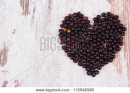 Heart Of Elderberry On Wooden Background, Symbol Of Love, Copy Space For Text