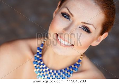 Summer portrait of beautiful red-haired woman.