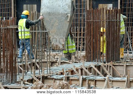 Group of construction workers concreting slab & beam at the construction site