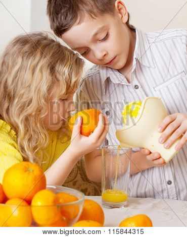 Children with oranges. Kids squeezed orange juice.