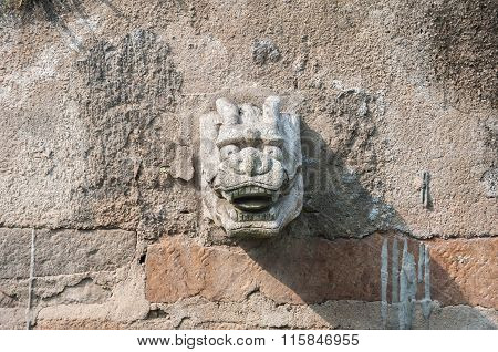 Stone Dragon Head Water Spout On A Suzhou Canal, China