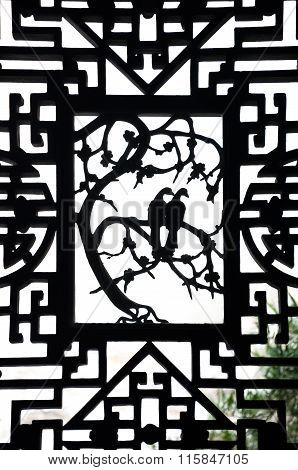 Dove design in a wooden window frame at Yuyuan garden, Shanghai