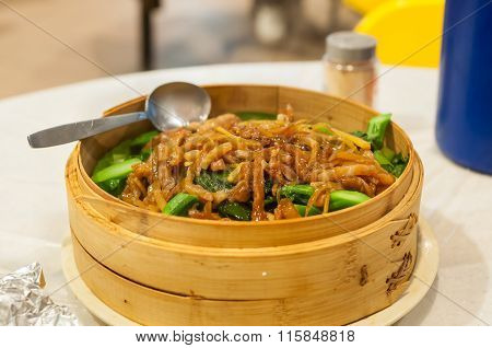 Sliced Pork And Chinese Kale Served At A Hong Kong Restaurant