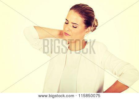 Businesswoman having huge neck pain