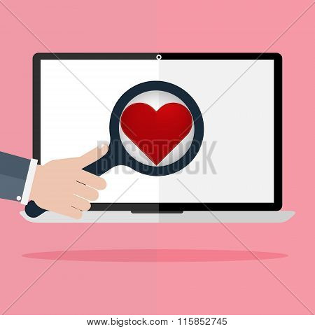 Human Hand Hold A Magnifying For Find Love And Heart Icon On Laptop Monitor On Pink Rays In Backgrou