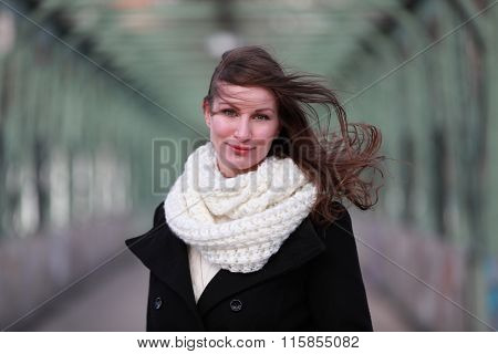 Beautiful brunette girl in winter clothes