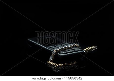 Jewelery With A Cell Phone On Gradient Dark Background