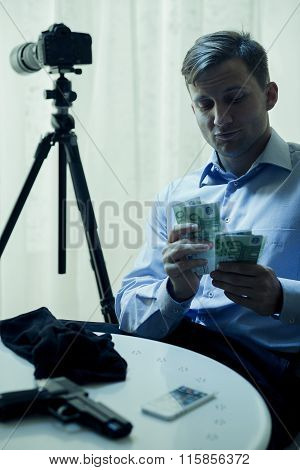 Contract Killer Counting His Salary