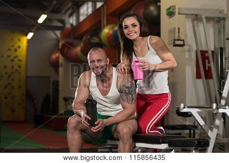 Couple Posing With Supplements For Copy Space