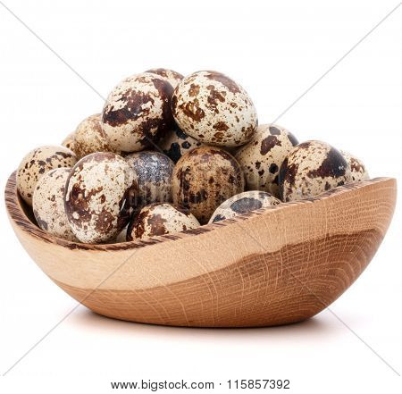 quail eggs in wooden bowl isolated on white background cutout