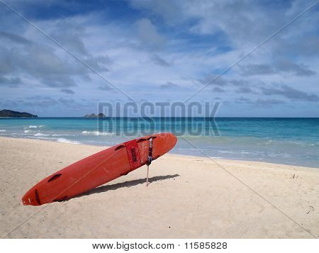 Life Guard Rescue Surfboard Sits On Waimanalo Beach