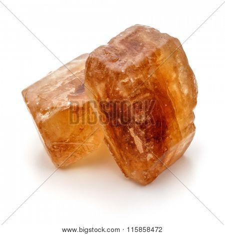 Brown caramelized lump cane sugar cube isolated on white background cutout