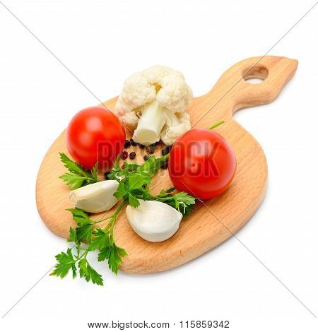 Vegetables And Spices On The Kitchen Board