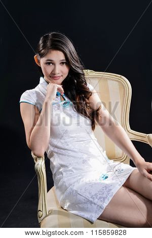 Portrait of fashion model clothes sitting old chair