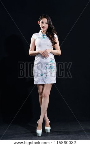 Full body young woman in white cheongsam chinese dress